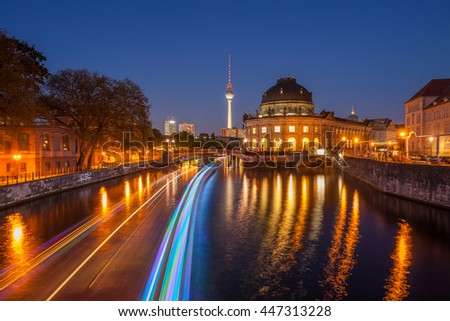 Berlin River Spree and famous round Bode Museum at twilight with TV Tower (Fernsehturm) - stock photo