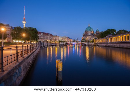 Berlin's River Spree, the Berliner Dom, and TV Tower (Fernsehturm) at twilight - stock photo
