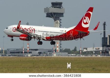 BERLIN - SCHONEFELD, GERMANY - JUNE 6: AirBerlin Boeing 737-800 (D-ABMV) landing on Berlin Schonefeld Airport - SXF. June 6, 2015. - stock photo