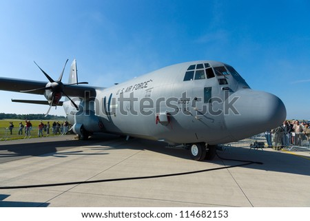"BERLIN - SEPTEMBER 14: Lockheed Martin C-130J Super Hercules is a turboprop military transport aircraft, International Aerospace Exhibition ""ILA Berlin Air Show"", September 14, 2012 in Berlin, Germany"