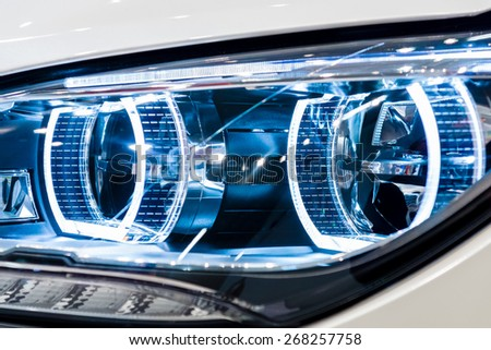 BERLIN - SEPTEMBER 09, 2012: Showroom. Headlamp of a Grand tourer / executive coupe BMW 640i Gran Coupe (F06). Close-up. Produced since 2012. - stock photo