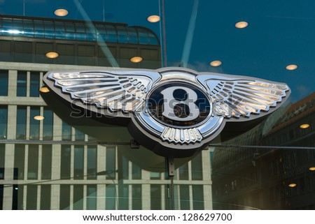 BERLIN - SEPTEMBER 04: The emblem Bentley dealership, September 04, 2012 in Berlin, Germany. Bentley Motors Limited is a British manufacturer of luxury automobiles. - stock photo