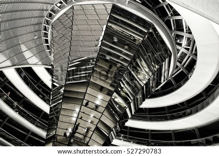 BERLIN, SEPTEMBER 19, 2006: Underside view on modern Reichstag dome interior made of glass and constructed as swirl with spiral footwalk on top of rebuilt Reichstag building. Architect: Norman Foster