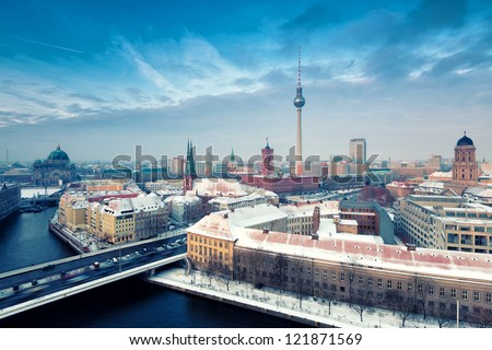 Berlin Skyline Winter City Panorama with snow and blue sky - famous landmark in Berlin, Germany, Europe