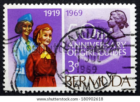 BERMUDA - CIRCA 1969: a stamp printed in Bermuda shows Girl Guides, Bermuda Girl Guides, 50th Anniversary, circa 1969 - stock photo
