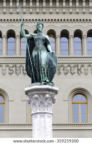 BERN, SWITZERLAND - DECEMBER 23, 2015: Female Statue of Berna placed on the top of  Berna Fountain (Bernabrunnen) This female figure personifies the city of Bern, like Helvetia personifies Switzerland - stock photo