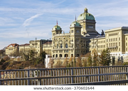 BERN, SWITZERLAND - DECEMBER 22, 2015: The Federal Palace, it is the seat of Federal Parliament (Swiss Federal Assembly), The Federal Council is housed here as well  - stock photo