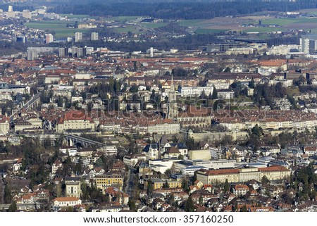 BERN, SWITZERLAND - DECEMBER 25, 2015: The historic old town of Bern seen in the distance. The Capital City of Switzerland it is the 4th most populous city in Switzerland