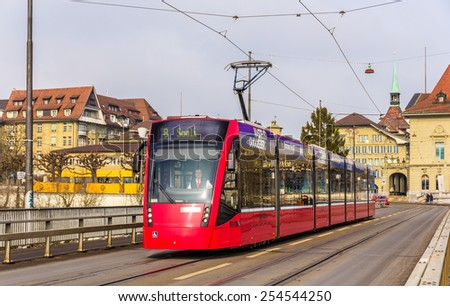 BERN, SWITZERLAND - FEBRUARY 15: Siemens Combino tram on Kirchenfeldbrucke in Bern on February 15, 2015. There are 36 trams of this class in Bern