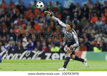 BERN, SWITZERLAND - JUNE 13:  Goalkeeper Gregory Coupet of France throws the ball during the UEFA Euro 2008 match against the Netherlands June 13, 2008 in Bern, Switzerland.  Editorial use only. - stock photo