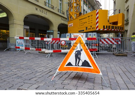 BERN, SWITZERLAND - SEPTEMBER 11, 2015: Due to repairs and the use of heavy vehicles, warning sign is placed on the road in the old town of Bern which is the 4th most populous city in the Country - stock photo