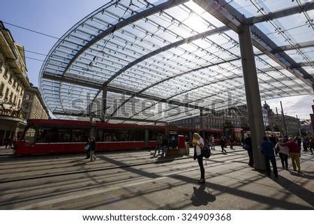 BERN, SWITZERLAND - SEPTEMBER 13, 2015: Glazed Canopy over the public tram and bus stop, built in 2008, The baldachin is the new symbol of the federal capital  - stock photo