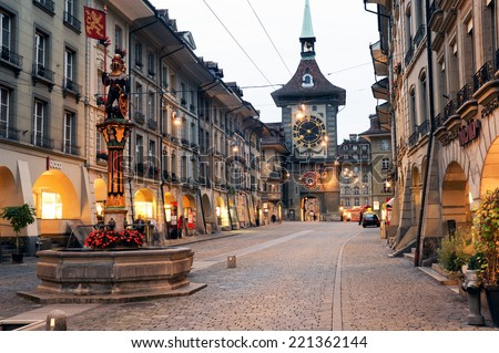 Bern, Switzerland - 17 September 2013: People on the shopping alley with the famous clocktower of Bern on Switzerland - stock photo