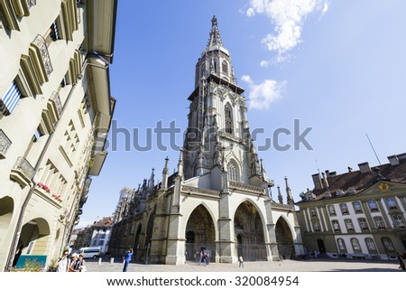 BERN, SWITZERLAND - SEPTEMBER 13, 2015: The Bern Minster (Berner Munster) in the old city built in the Gothic style, it is the tallest cathedral in Switzerland with a height of 100.6 m - stock photo