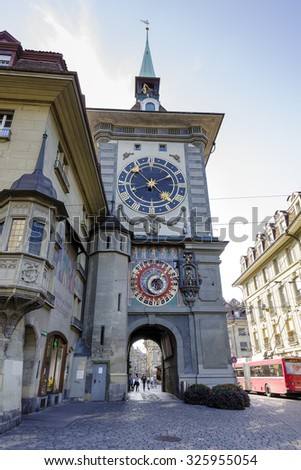 BERN, SWITZERLAND - SEPTEMBER 13, 2015: The east front of the Clock Tower (1191-1256), Zytglogge, Swiss Cultural Property of National Significance located at the end of the Kramgasse in Old City  - stock photo