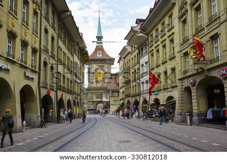 BERN, SWITZERLAND - SEPTEMBER 11, 2015: The west front of the Clock Tower, Zytglogge, Swiss Cultural Property of National Significance, it is seen at the end of Marktgasse in Old Town  - stock photo