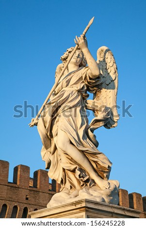 Bernini's marble statue of angel with cross from the Sant'Angelo Bridge in Rome, Italy - stock photo