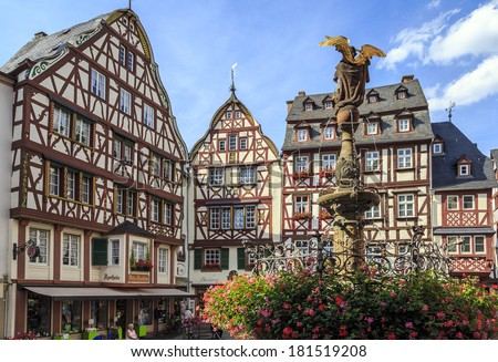 BERNKASTEL, GERMANY - AUGUST 05: Tourists stroll on August 05, 2013 in Bernkastel, Germany. According to its Tourism Office, the town is annually visited by 1.5m tourists. Region is famous for wines.  - stock photo