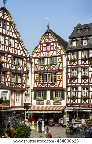 BERNKASTEL KUES, GERMANY - SEP 19, 2009: tourists visit the village with frame house in romantic Bernkastel Kues at the river Mosel.