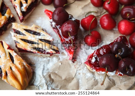 berries and cake on paper - stock photo