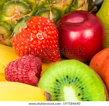 Berries and fruit closeup. Strawberries and kiwi, plum and raspberry closeup background.