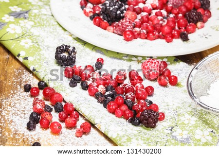 Berries covered with powdered sugar. - stock photo