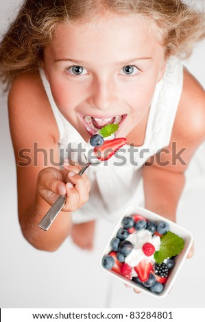 Berries - Cute girl eating fresh berries