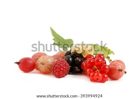 Berries. Fresh Berries on white background. Ripe sweet Raspberry, currant and gooseberry. Berries with leaves. Healthy Berries. Berries isolated on white.  - stock photo