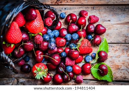 Berries mix on rustic background - stock photo