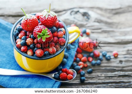 Berries on Wooden Background. Summer Organic Berry over Wood. Agriculture, Gardening, Harvest Concept - stock photo