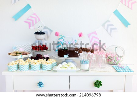 Berries, popcorn and canape selection at party table - stock photo
