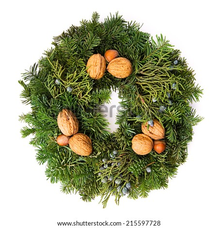 Berries, sprigs of evergreen pine or spruce, walnuts and hazelnuts formed into a wreath.  - stock photo
