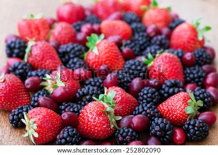 Berries, summer fruit on wooden table. Healthy lifestyle concept, Selective focus. - stock photo