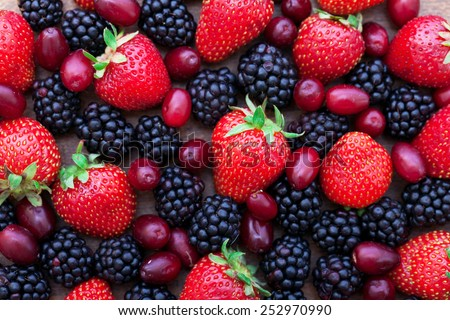 Berries, summer fruit on wooden table. Healthy lifestyle concept, Top view horizontal, Selective focus - stock photo
