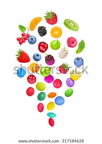 berries transform into colorful candy in the glaze isolated on white background