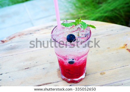 Berries with soda water - stock photo