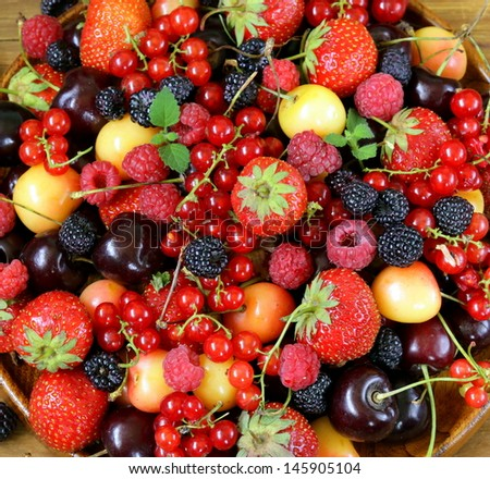 berry background is fresh and ripe fruit - stock photo