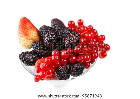 Berry cocktail in martini glass isolated over white background