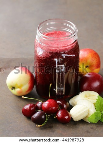 berry fruit drink smoothies with cherries, plums - healthy food - stock photo