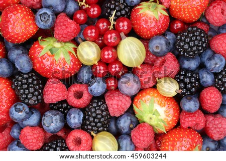Berry fruits berries collection strawberries, blueberries raspberries red currants background top view