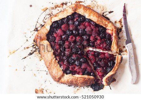 berry galette on a parchment paper
