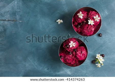 Berry ice cream or sorbet with fresh berry on vintage background, selective focus