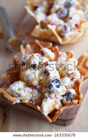 Berry ice creame in waffle with sweet sauce - stock photo