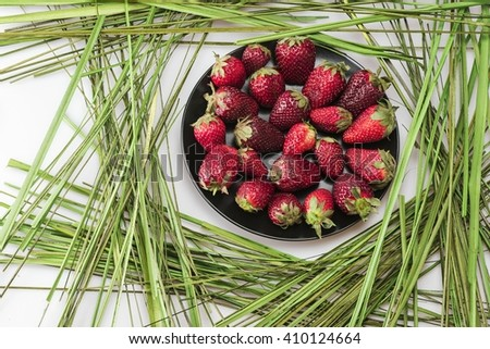 Berry laid out on a black plate - stock photo