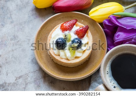 Berry mini tart and cup coffee