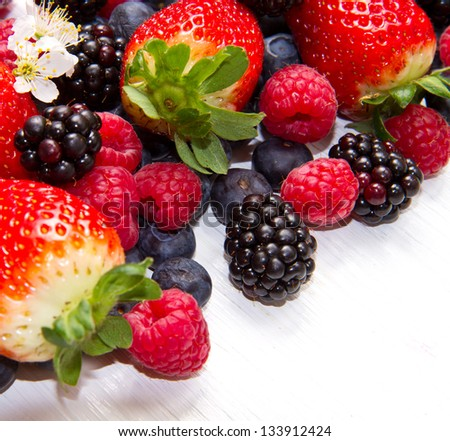 Berry over white  Wood. Strawberries, Raspberries, Blueberry - stock photo
