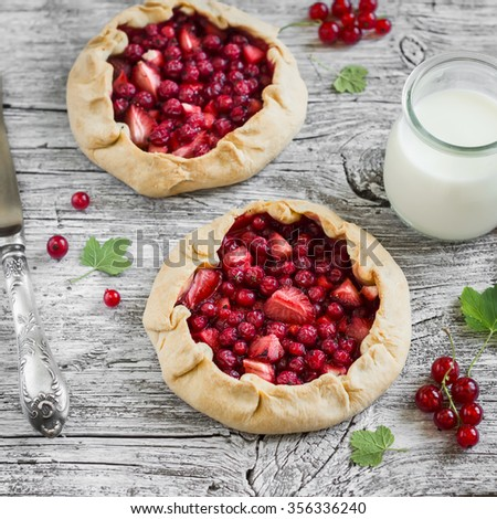 berry pie on a light rustic  wooden background