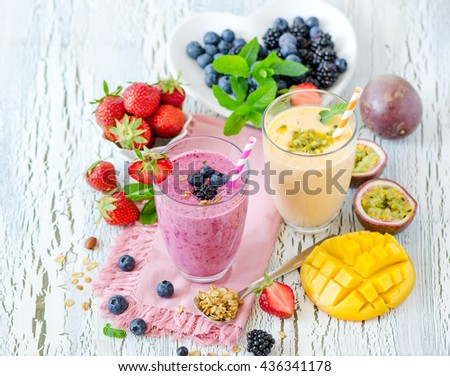 Berry smoothie, healthy summer detox yogurt drink, diet or vegan food concept, fresh vitamins, homemade refreshing cocktail - stock photo