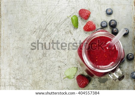 Berry smoothie on rustic  background - Healthy eating, Detox or Diet concept - stock photo