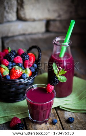 Berry smoothie on rustic wooden background - stock photo